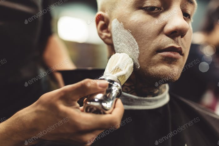Anonymous barber shaving client