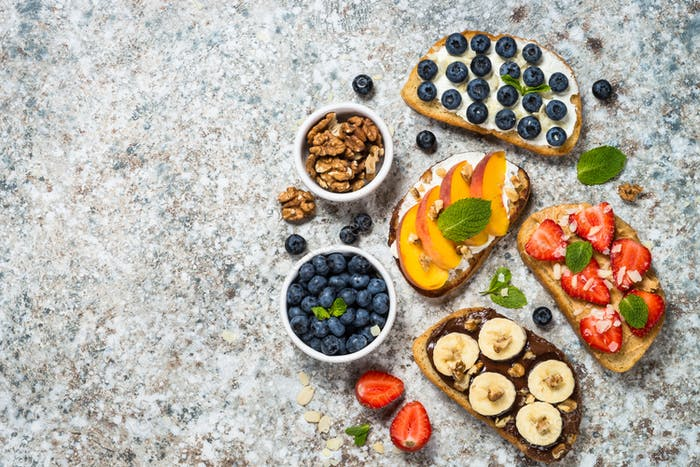 Sweet toast assortment with fresh fruit and berries