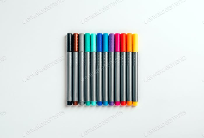Set of multicolor felt pens, markers on white background, colorful fineliners