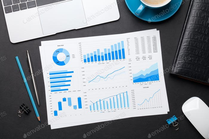 Office workplace table with reports