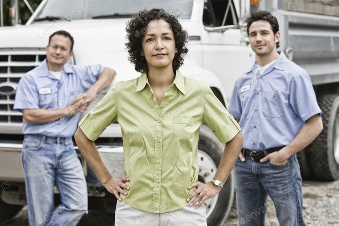 Mixed race team of workers at a landscape company with a woman in the lead.