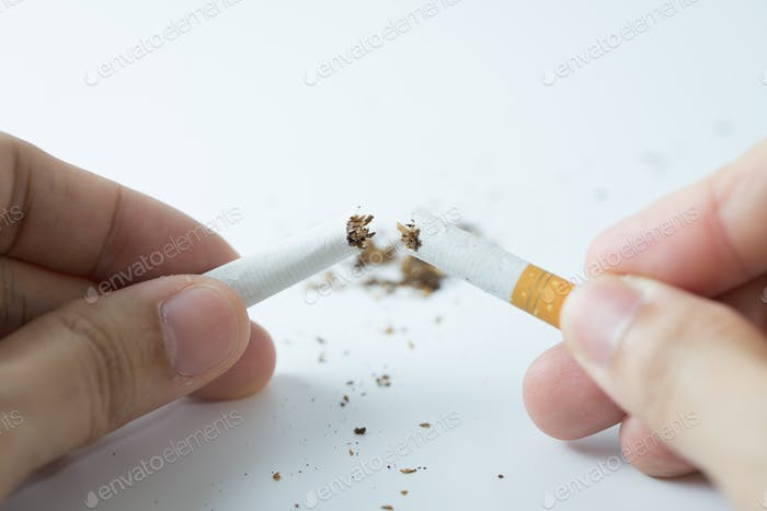 Quit smoking concept by breaking the cigarette