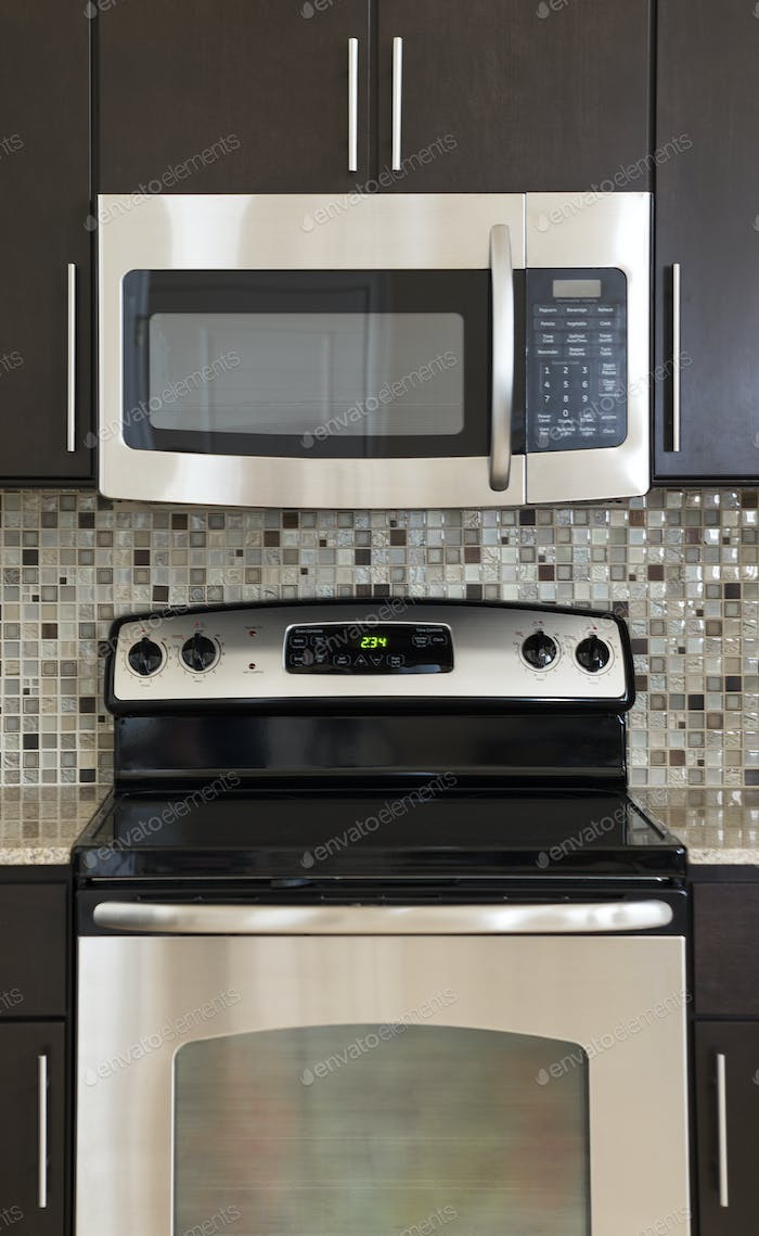 54249,Microwave and stove in modern kitchen