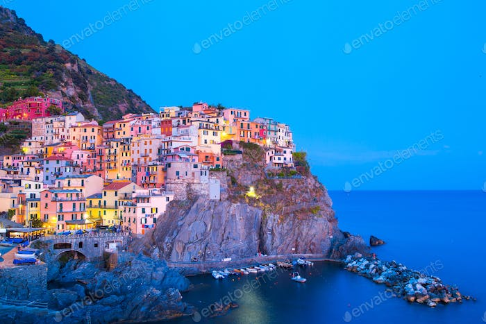 View on architecture of Manarola town in sunset light. Manarola is one of the most popular town in