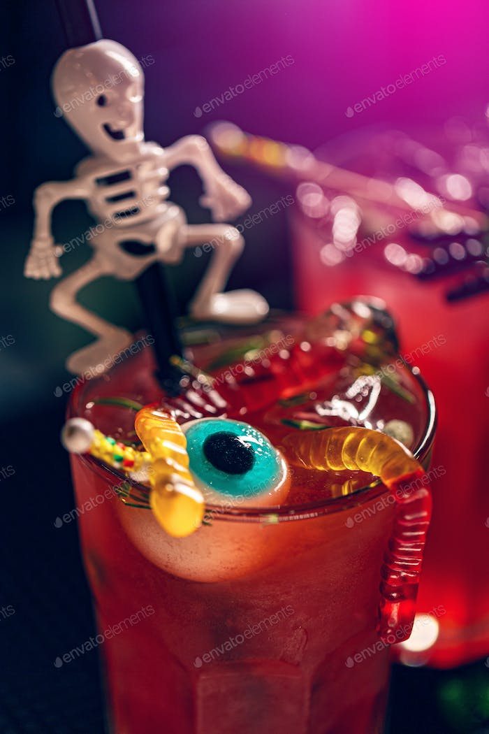 Halloween cocktail with halloween decor