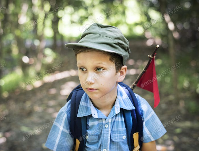 Boy hiking through a forest