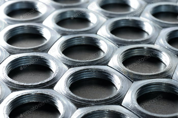 Close-up chrome metal nuts. Metal lines