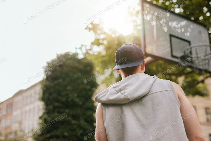 Streetball player standing outdoors on court