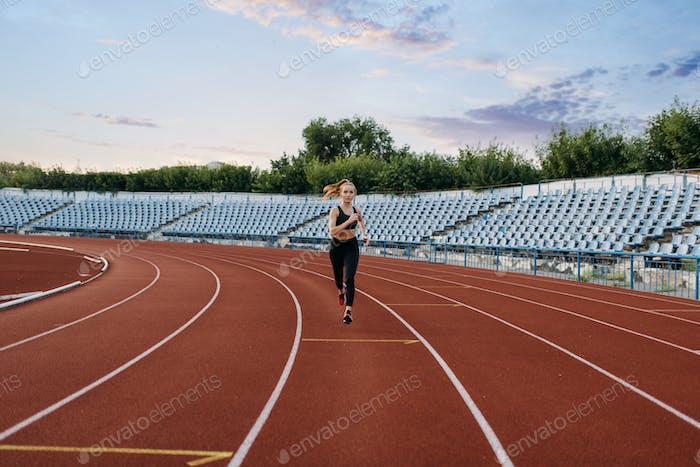 Female jogger running, training on stadium