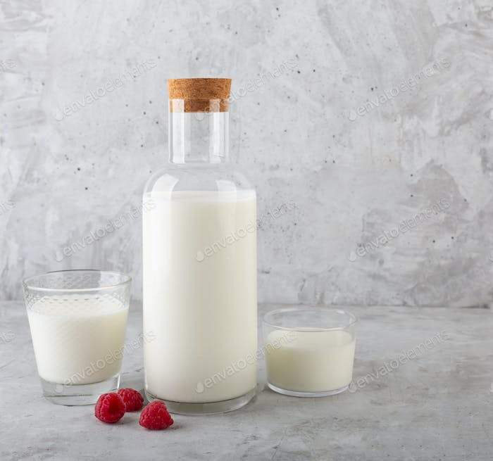 Kefir drink with raspberry on the gray background