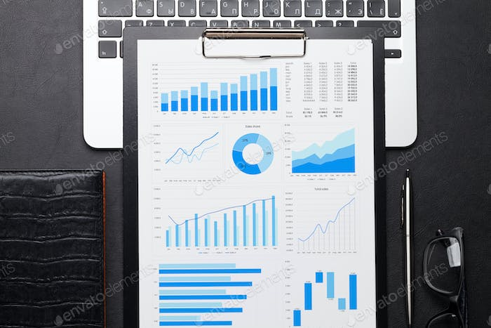 Office workplace table with charts