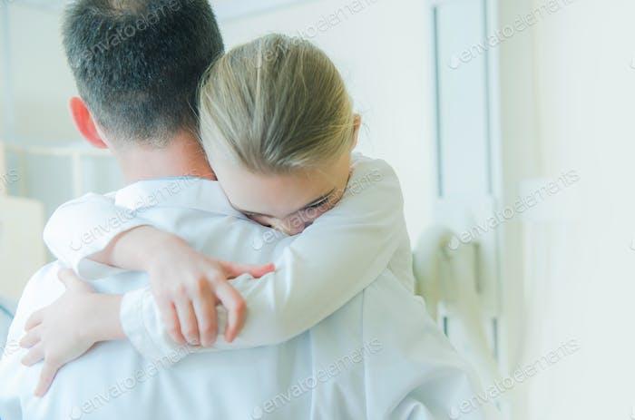 Little Girl on Doctors Hands