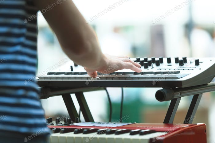 Keyboard player of a pop group during a show