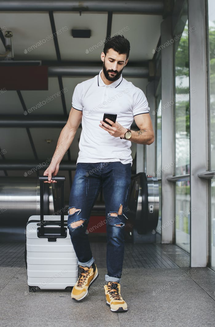 White man carrying luggage