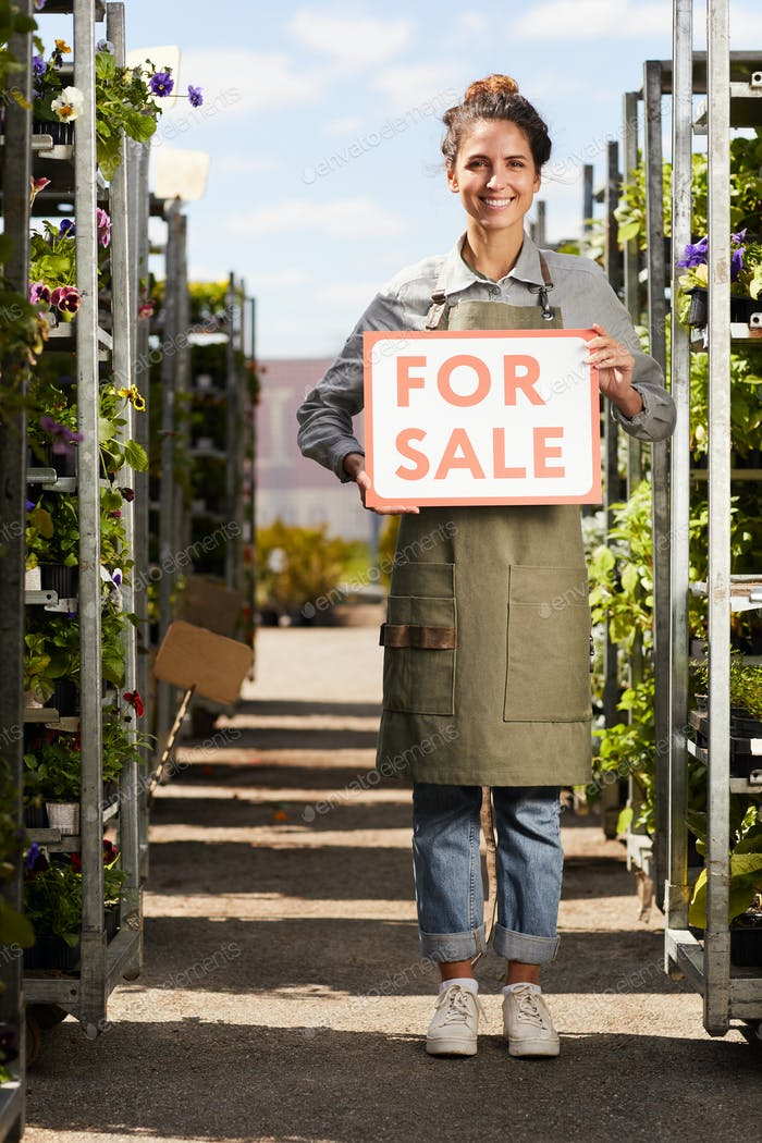 Woman Holding For Sale Sign at Plantation
