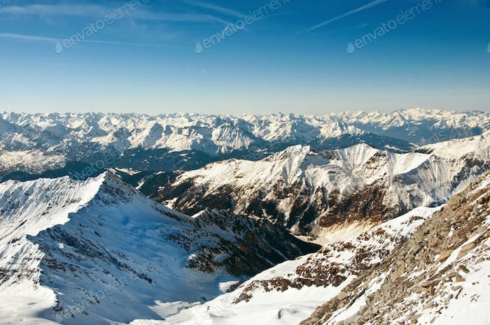 Winter landscape on a skiing resort in the Alps with mountains b