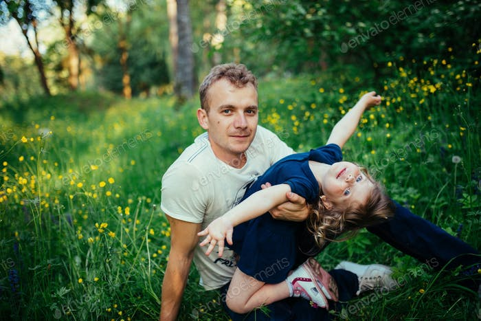 daughter and dad in nature