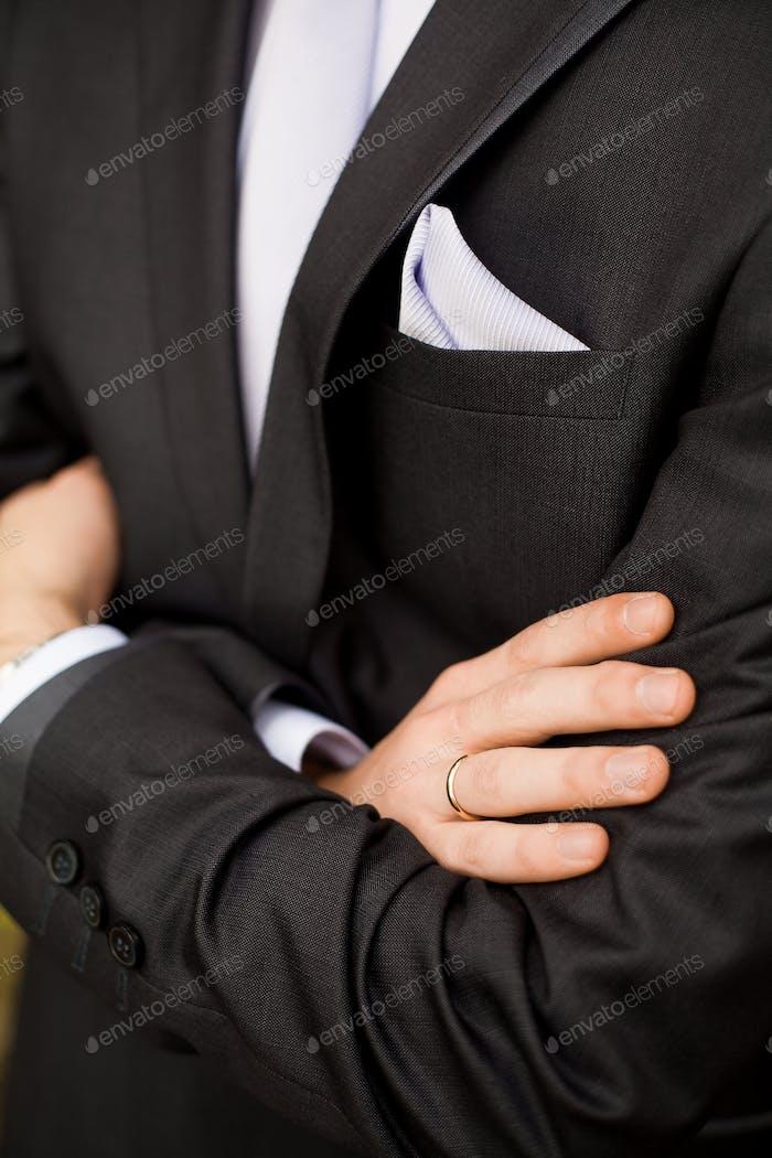 Groom crossing hands