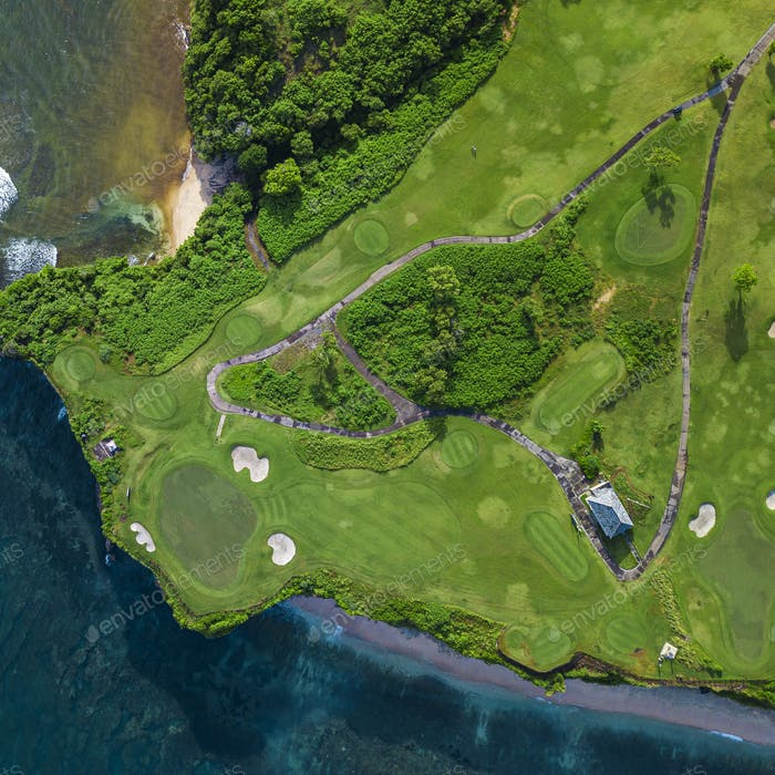 Aerial view of golf course with  green at coast