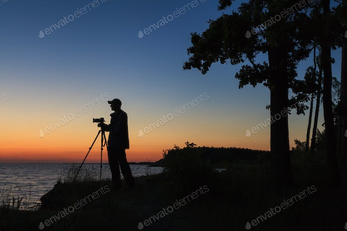 Photographer silhouette at sunset