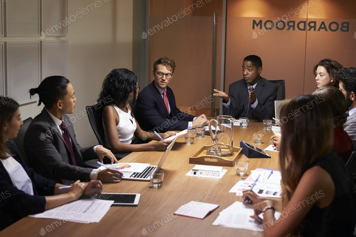 Businessman addressing corporate colleagues at a meeting