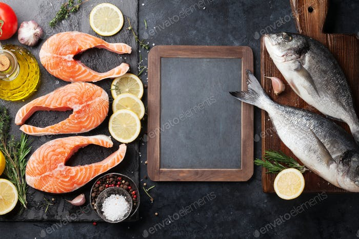 Raw salmon fish fillet and dorado