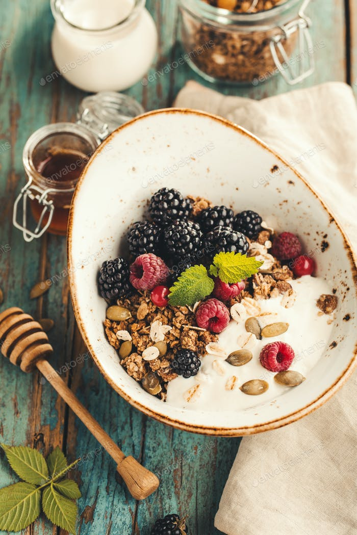 Homemade granola with raspberries and blackberries