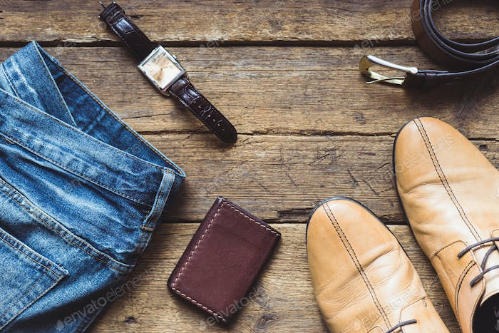 Men's clothes and accessories on wooden background. Top view