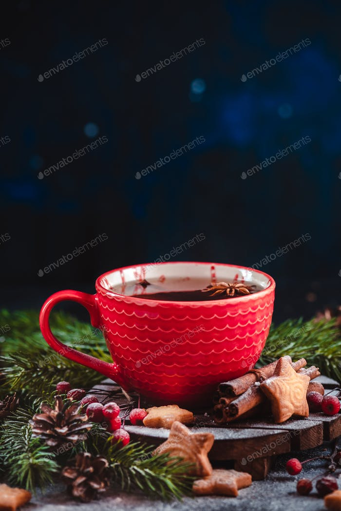 Christmas hot tea with cinnamon, and star-shaped cookies. Large coffee cup with homemade cocoa
