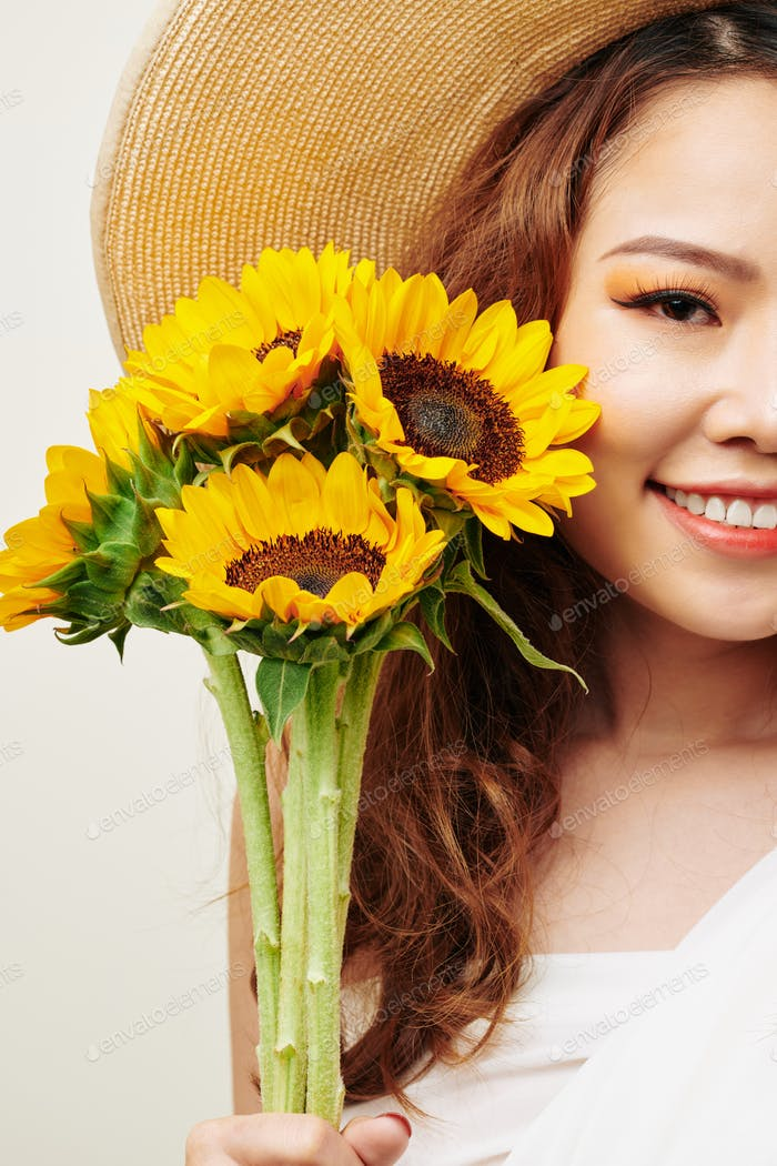 Asian woman with sunflowers