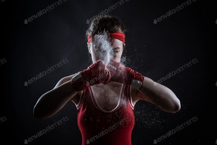 Female athlete in boxing bandages and sportswear