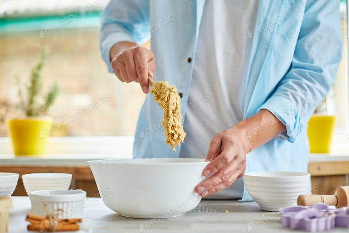 Man, male forming the dough in Bowl a and kneading at home