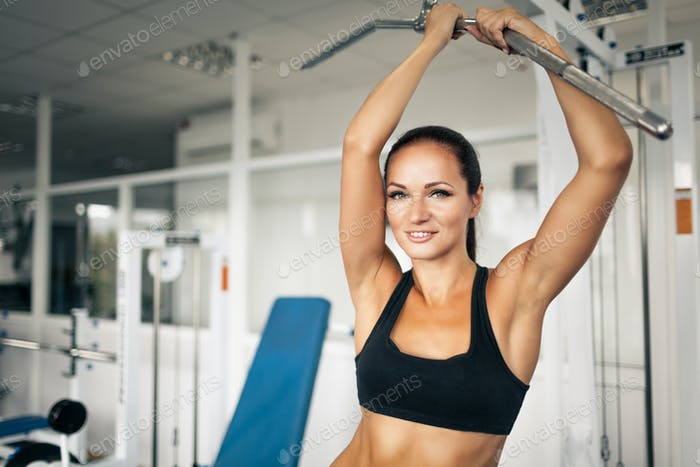 Young woman having strength workout