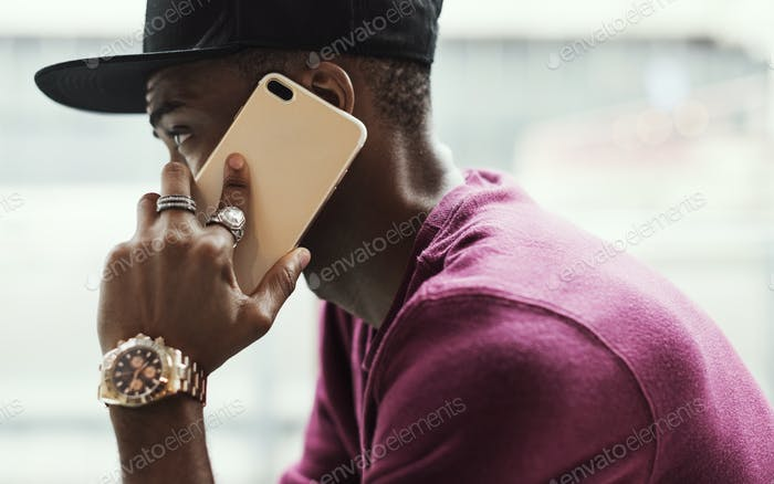 African man using mobile phone