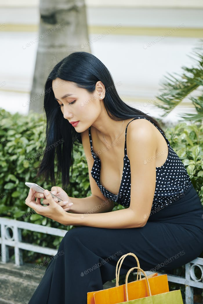 Asian girl using mobile phone