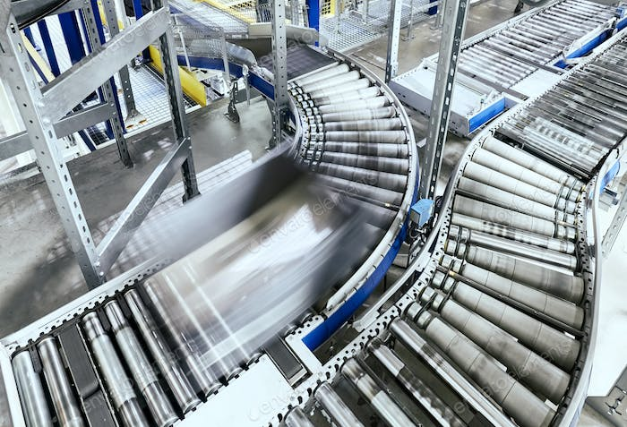 Modern conveyor system with box in motion
