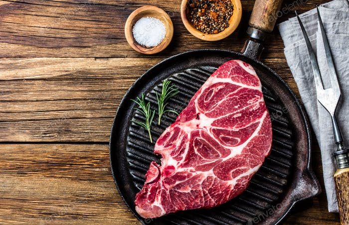 Raw marbled beef steak on grill pan