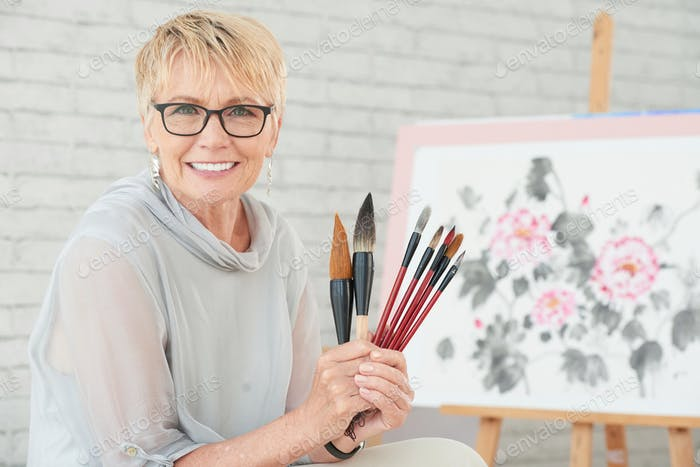 Woman with paintbrushes