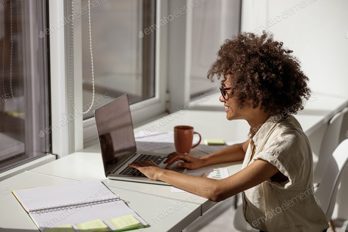 African American woman concentrated looking at computer screen