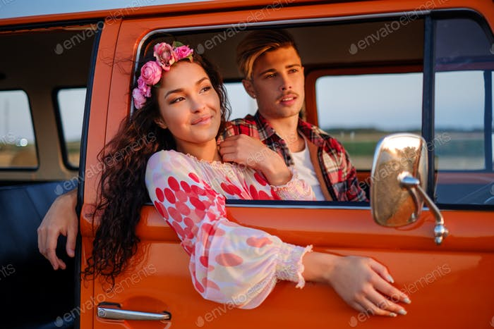 Hippie couple in a van on a road trip