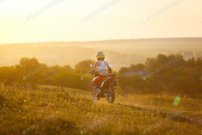 Woman biker in sunset, female motorcycle.