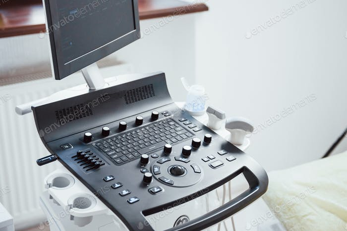 Close up view of control desk of ultrasound device in the clinic