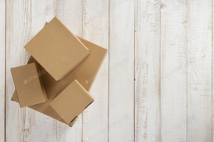 cardboard box on wooden background