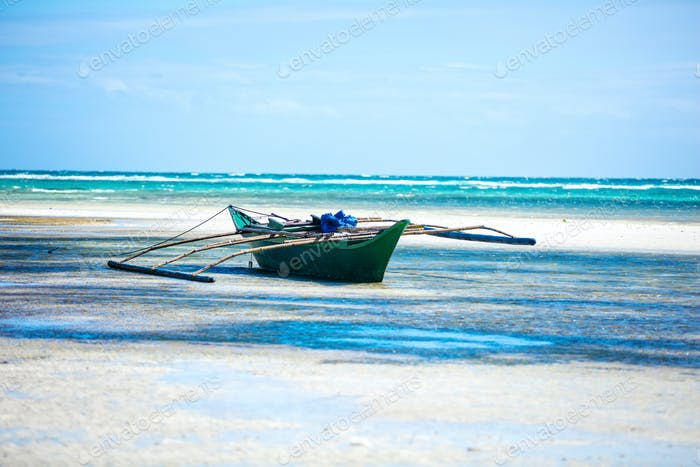 Small asian boat in shallow sea waters