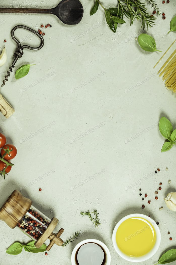 Olive oil, balsamic vinegar, salt, pepper, herbs, pasta, tomatoes on concrete background