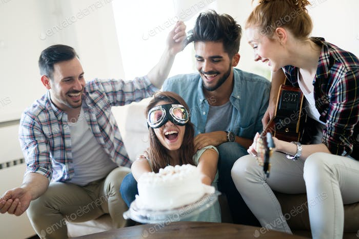 Cheerful young friends having fun on party