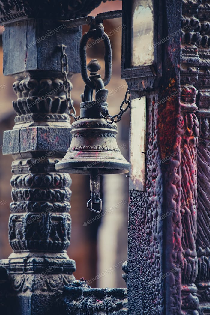Traditional Nepalese bell in a very old and small temple in Nepal