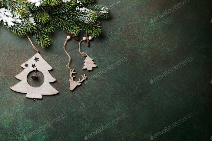 Christmas background with snow fir tree and decor
