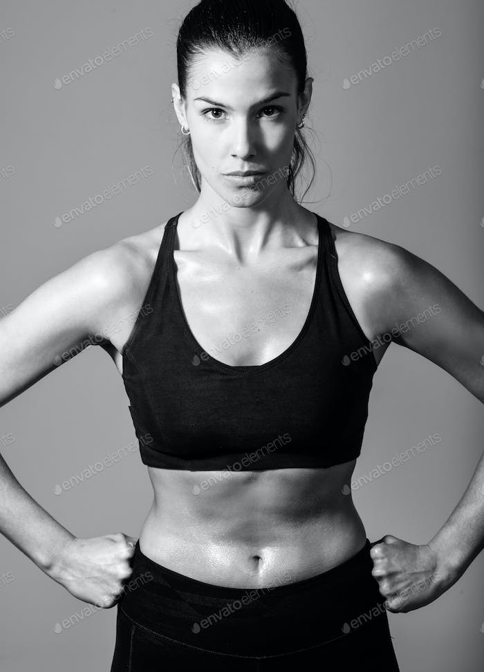 Woman, personal trainer, wearing black sportswear