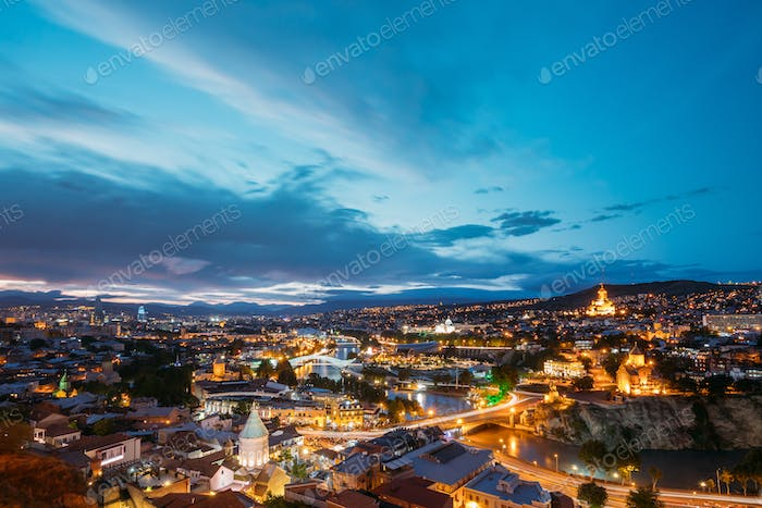 Scenic Top View Of Tbilisi Georgia In Evening Illumination With